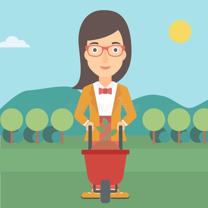 Γυναίκα με τις εγκαταστάσεις και wheelbarrow ελεύθερη απεικόνιση δικαιώματος