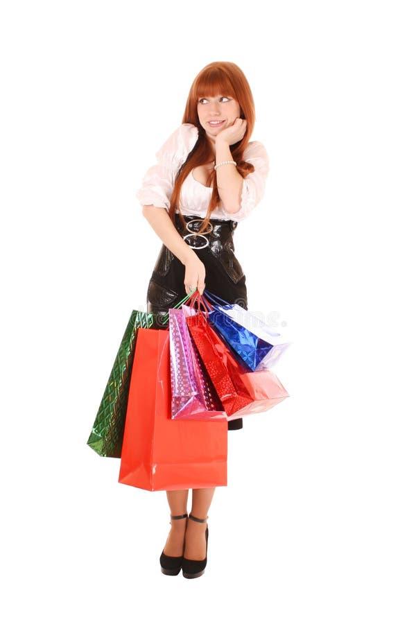 γυναίκα με τις τσάντες αγορών χρώματος στοκ εικόνες με δικαίωμα ελεύθερης χρήσης