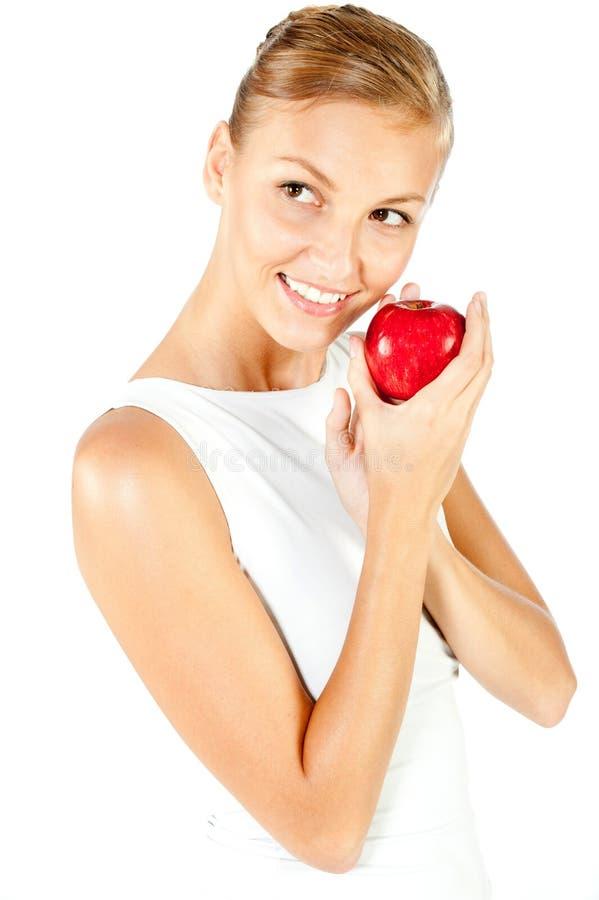 Γυναίκα με το κόκκινο μήλο στοκ εικόνα