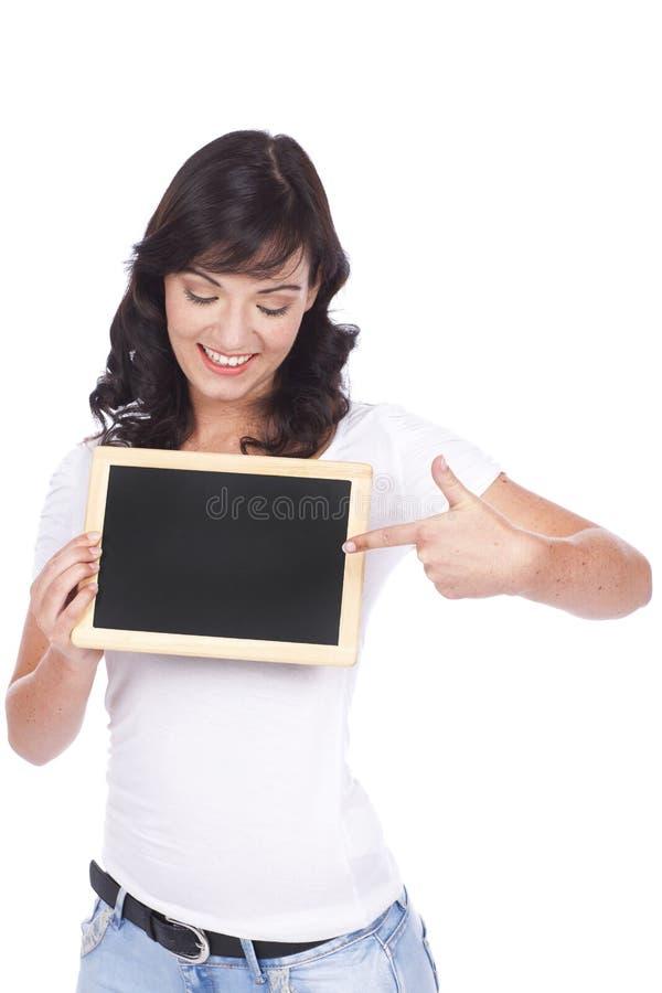 Γυναίκα με το μαύρο πίνακα στοκ φωτογραφία με δικαίωμα ελεύθερης χρήσης