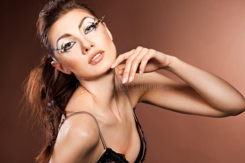 Γυναίκα με το visage τέχνης στοκ εικόνες με δικαίωμα ελεύθερης χρήσης