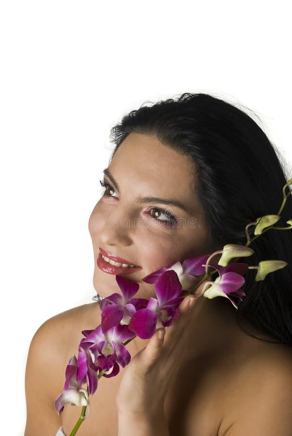 Γυναίκα με orchid στοκ εικόνες