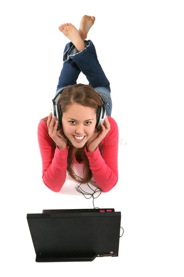 γυναίκα μουσικής lap-top στοκ εικόνες