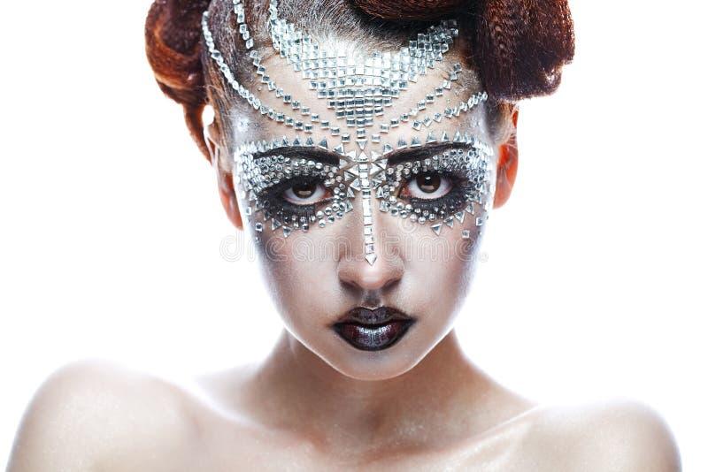 Γυναίκα ομορφιάς στο φουτουριστικό makeup στοκ φωτογραφία
