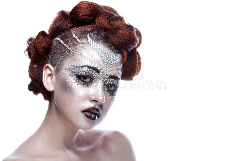 Γυναίκα ομορφιάς στο φουτουριστικό makeup στοκ εικόνες