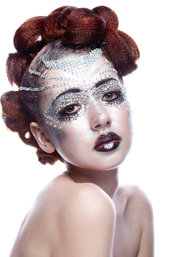Γυναίκα ομορφιάς στο φουτουριστικό makeup στοκ εικόνα