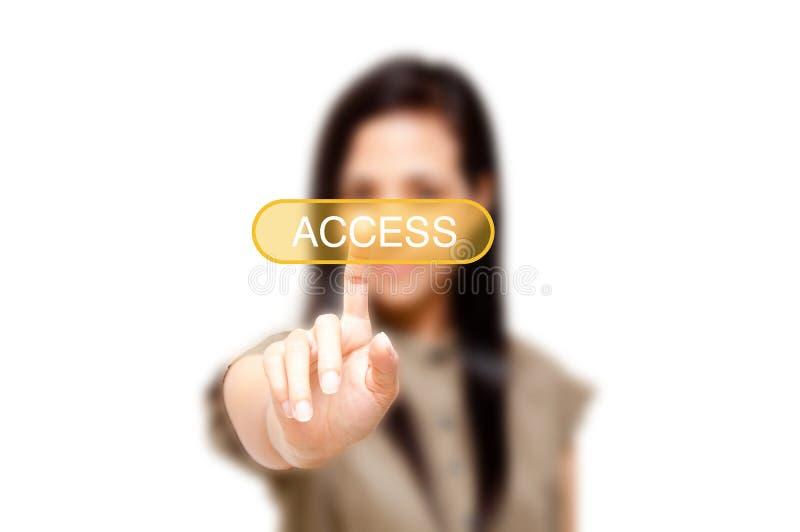 Γυναίκα που αγγίζει στο κουμπί πρόσβασης στοκ εικόνα με δικαίωμα ελεύθερης χρήσης