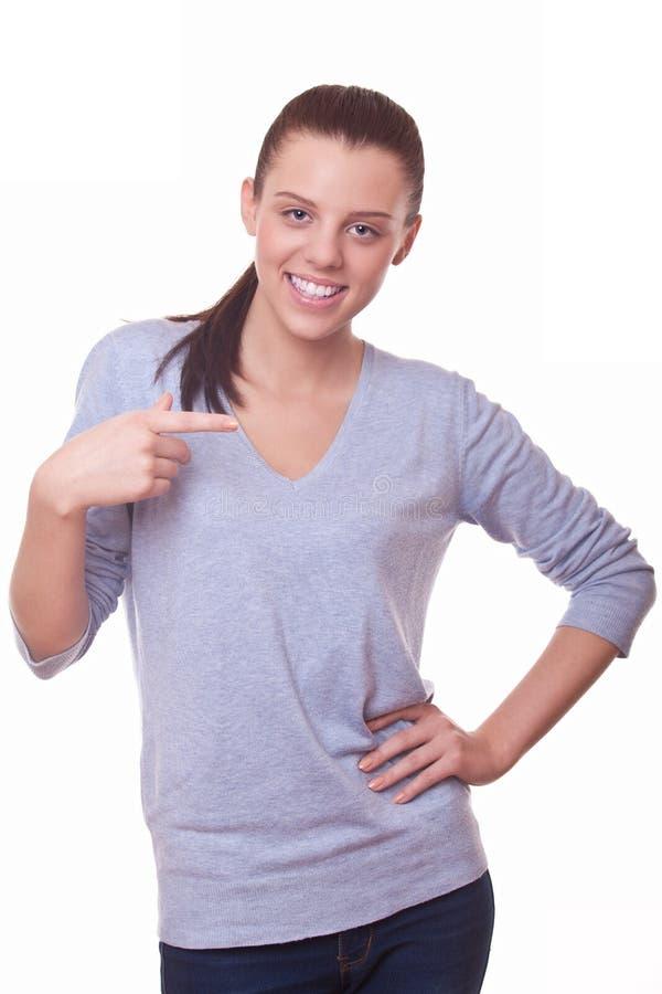 Γυναίκα που δείχνει το δάχτυλό της κατά μέρος στοκ φωτογραφία με δικαίωμα ελεύθερης χρήσης