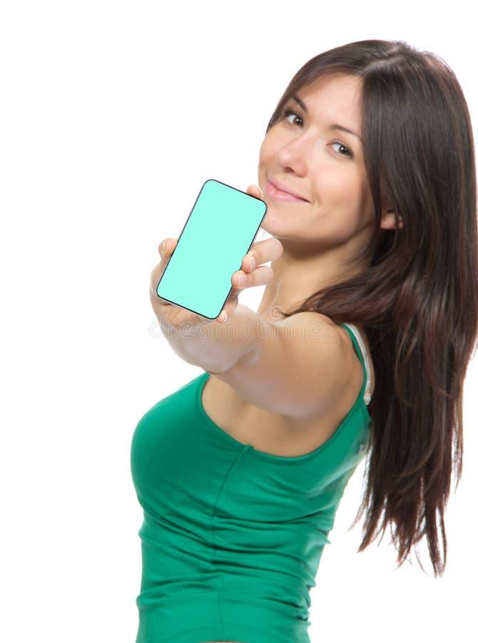 Γυναίκα που εμφανίζει στην παρουσίαση κινητό τηλέφωνο κυττάρων στοκ φωτογραφία