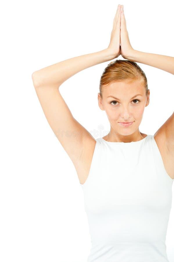 Γυναίκα που κάνει τη γιόγκα στοκ φωτογραφία