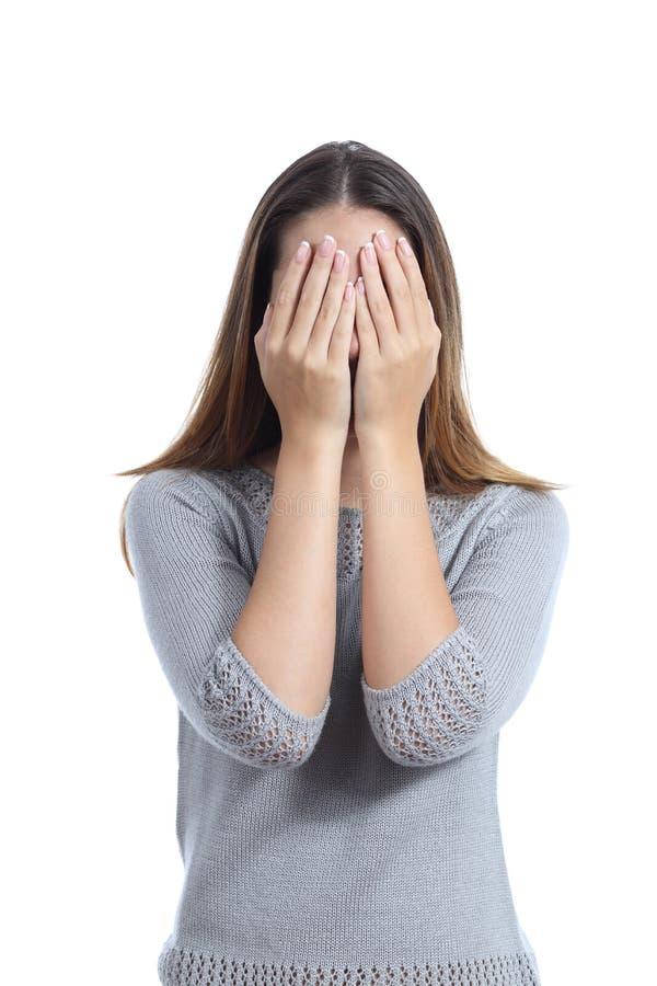 Γυναίκα που καλύπτει το πρόσωπό της και με τα δύο χέρια στοκ εικόνες