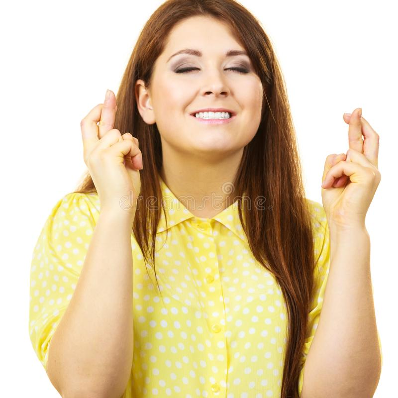 Γυναίκα που κρατά τα δάχτυλά της διασχισμένα στοκ εικόνες με δικαίωμα ελεύθερης χρήσης