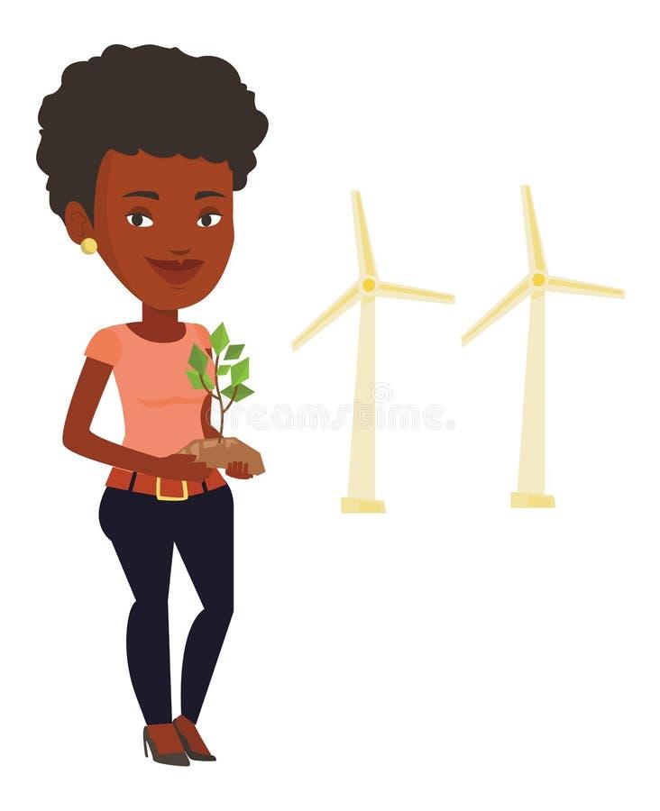 Γυναίκα που κρατά τις πράσινες μικρές εγκαταστάσεις ελεύθερη απεικόνιση δικαιώματος