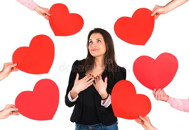 Γυναίκα που λαμβάνει τις κόκκινες καρδιές στοκ φωτογραφία με δικαίωμα ελεύθερης χρήσης
