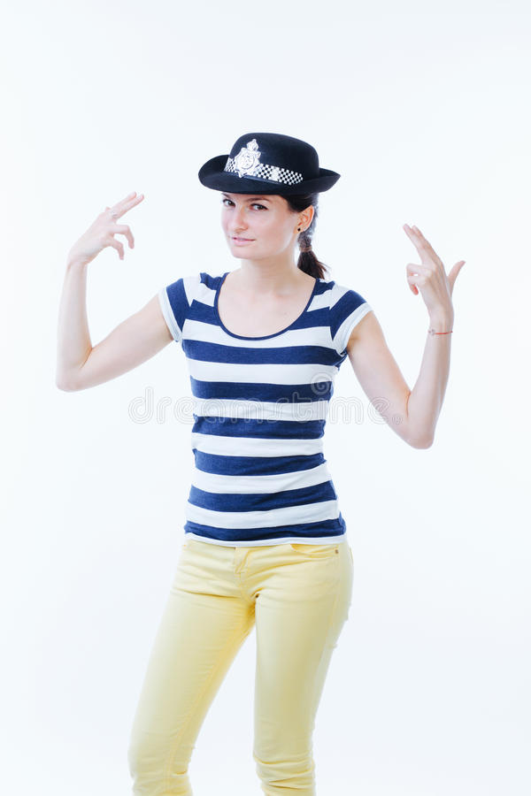 Γυναίκα που μιμείται έναν αστυνομικό στοκ εικόνες
