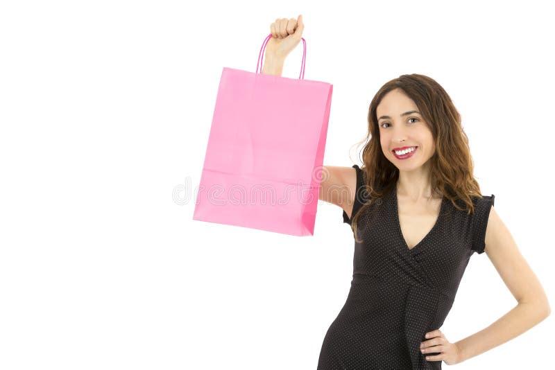Γυναίκα που παρουσιάζει τσάντα αγορών εγγράφου στοκ εικόνες