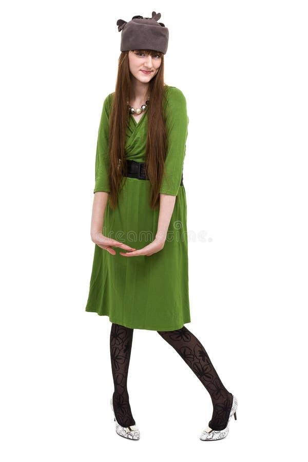 Γυναίκα που φορά ένα πράσινο φόρεμα που απομονώνεται στο άσπρο υπόβαθρο στοκ εικόνες με δικαίωμα ελεύθερης χρήσης