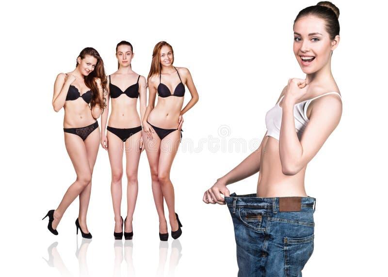 Γυναίκα που φορά τα παλαιά μεγάλα τζιν στοκ φωτογραφία με δικαίωμα ελεύθερης χρήσης