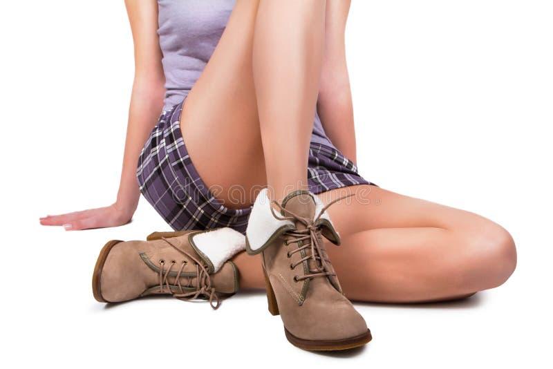 Γυναίκα που φορά τις μπότες στοκ εικόνα με δικαίωμα ελεύθερης χρήσης