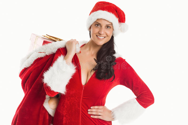 Γυναίκα που χαμογελά με τα χριστουγεννιάτικα δώρα στοκ εικόνες