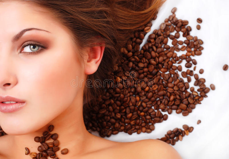 γυναίκα προσώπου s καφέ φα&si στοκ φωτογραφία με δικαίωμα ελεύθερης χρήσης
