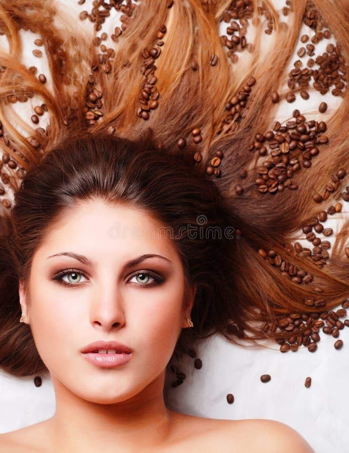 γυναίκα προσώπου s καφέ φα&si στοκ εικόνα