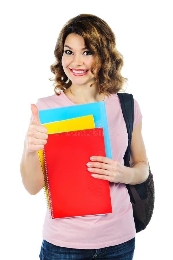 Γυναίκα σπουδαστής με τα σημειωματάρια που απομονώνεται στο λευκό στοκ φωτογραφία με δικαίωμα ελεύθερης χρήσης