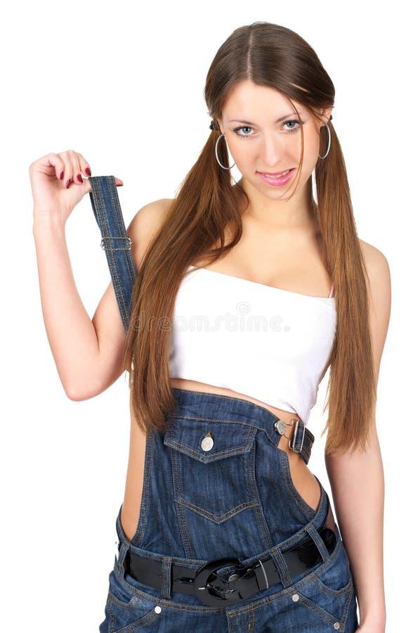Γυναίκα στις φόρμες τζιν στοκ εικόνα