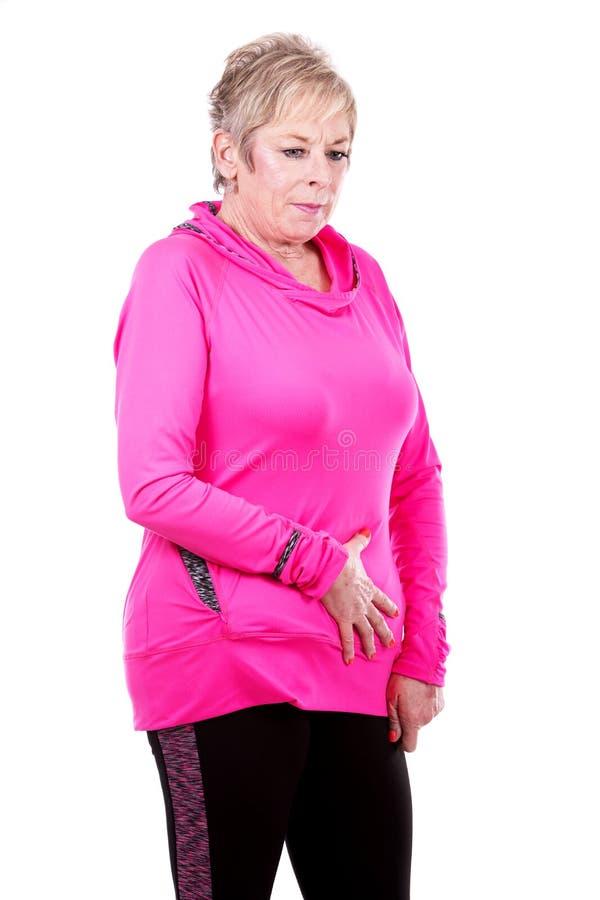 γυναίκα στομαχιών πόνου στοκ εικόνες