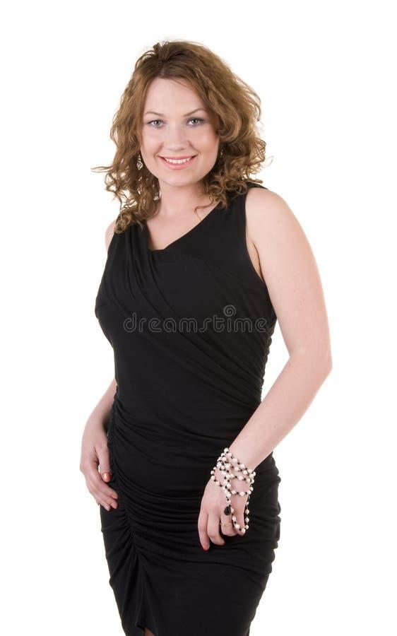 Γυναίκα στο μαύρο φόρεμα βραδιού στοκ φωτογραφία