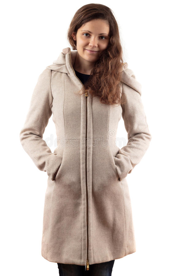 Γυναίκα στο μπεζ παλτό Στοκ Εικόνες
