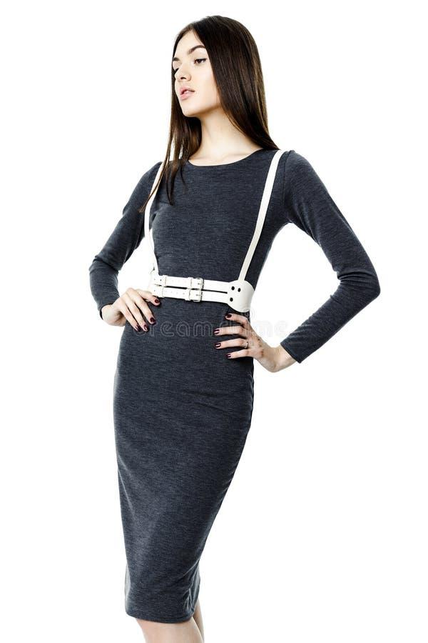 Γυναίκα στο φόρεμα και τη ζώνη στοκ εικόνες
