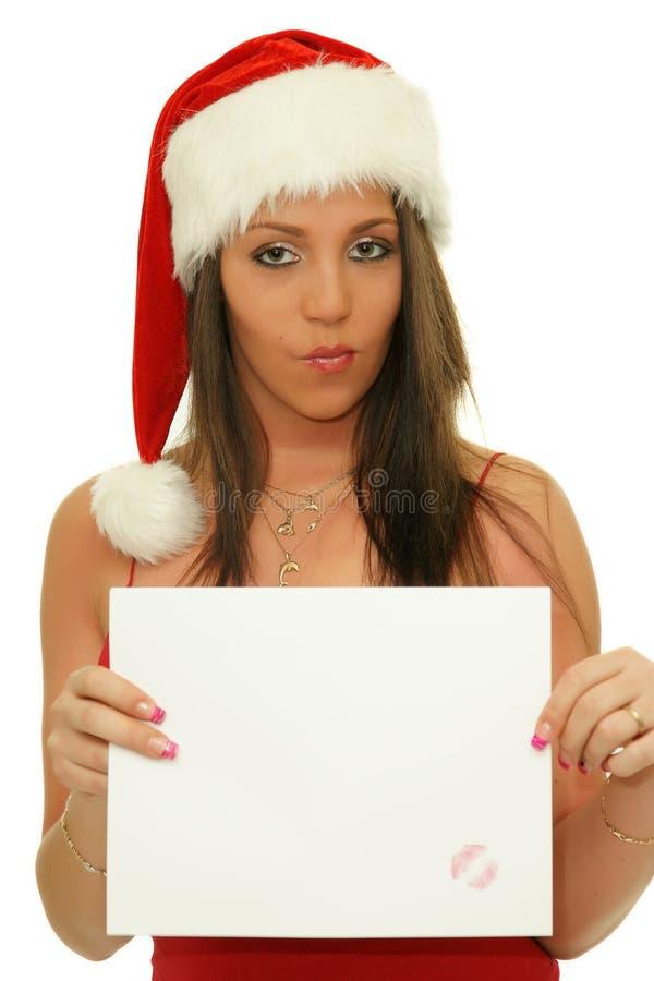 Γυναίκα Χριστουγέννων που εμφανίζει στο αντίγραφο διαστημικό σημάδι στοκ φωτογραφία με δικαίωμα ελεύθερης χρήσης
