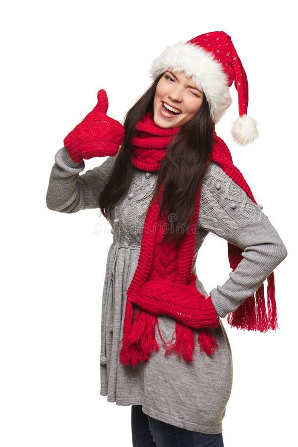 Γυναίκα Χριστουγέννων που παρουσιάζει αντίχειρα στοκ φωτογραφίες με δικαίωμα ελεύθερης χρήσης