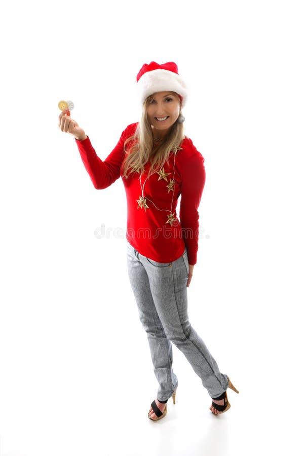 Γυναίκα Χριστουγέννων που παρουσιάζει συστήνοντας το cryptocurrency στοκ εικόνα