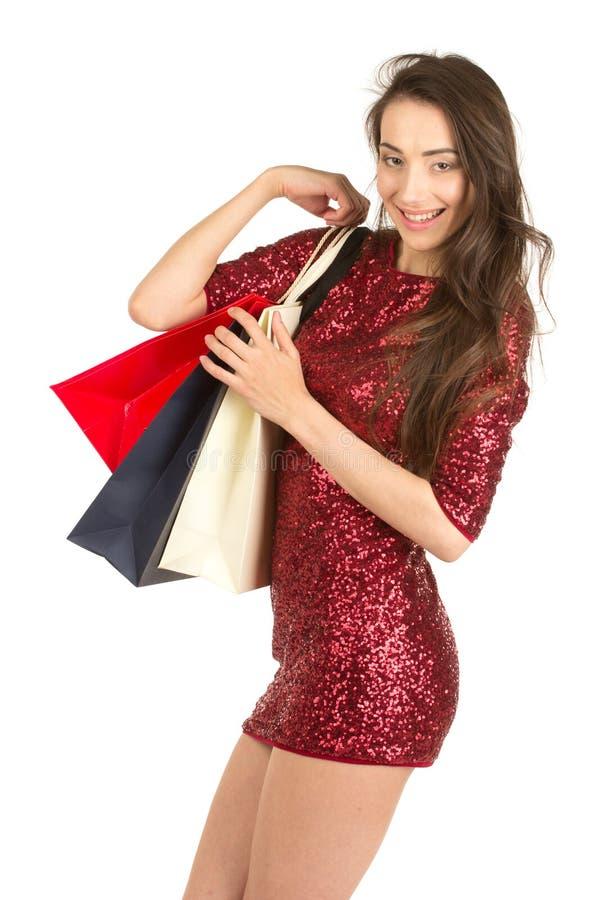 Γυναίκα Brunett με τις τσάντες αγορών στοκ φωτογραφία με δικαίωμα ελεύθερης χρήσης