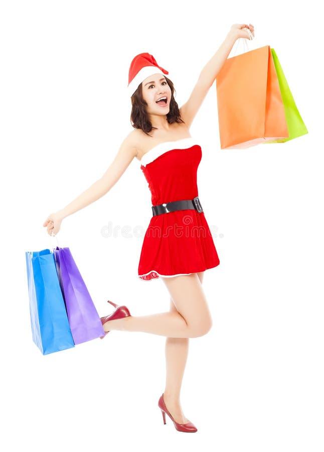 Γυναίκα santa Χριστουγέννων που κρατά μερικές τσάντες δώρων στοκ εικόνες