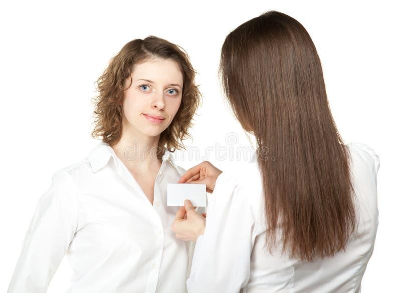 γυναίκες επιχειρησιακής στερεώνοντας συνεδρίασης διακριτικών στοκ εικόνες