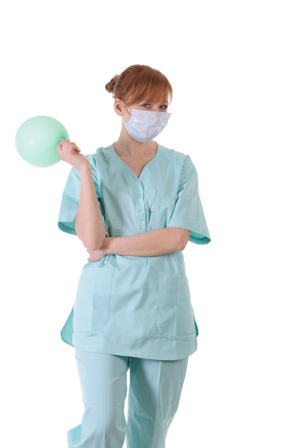 Γυναικείος γιατρός με την τοποθέτηση σφαιρών αναπνευστικών συσκευών και αέρα στοκ εικόνες με δικαίωμα ελεύθερης χρήσης