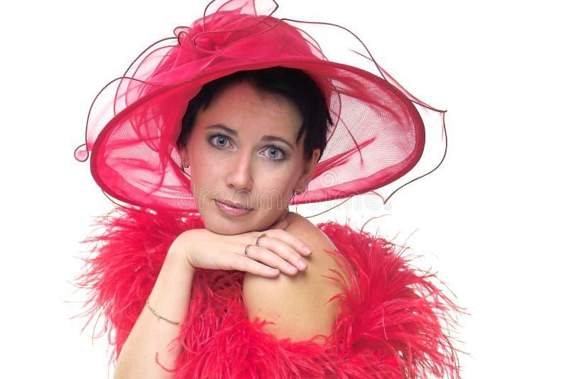 Download γυναικείο κόκκινο καπέλ& στοκ εικόνες. εικόνα από περιστασιακός - 389656