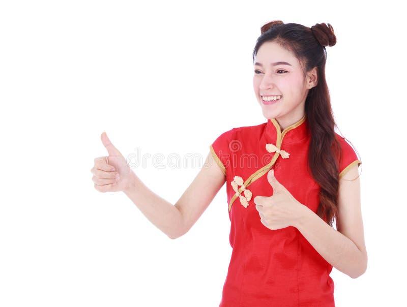 Γυναικών cheongsam και αντίχειρας ένδυσης κόκκινο επάνω στην έννοια των ευτυχών ραχών στοκ εικόνες με δικαίωμα ελεύθερης χρήσης