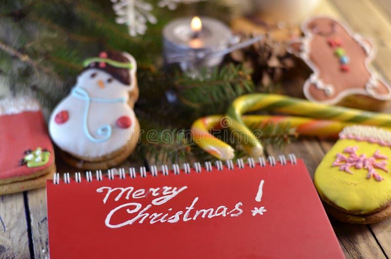 Γλυκά Χριστουγέννων και χαιρετισμοί Χριστουγέννων στοκ εικόνες