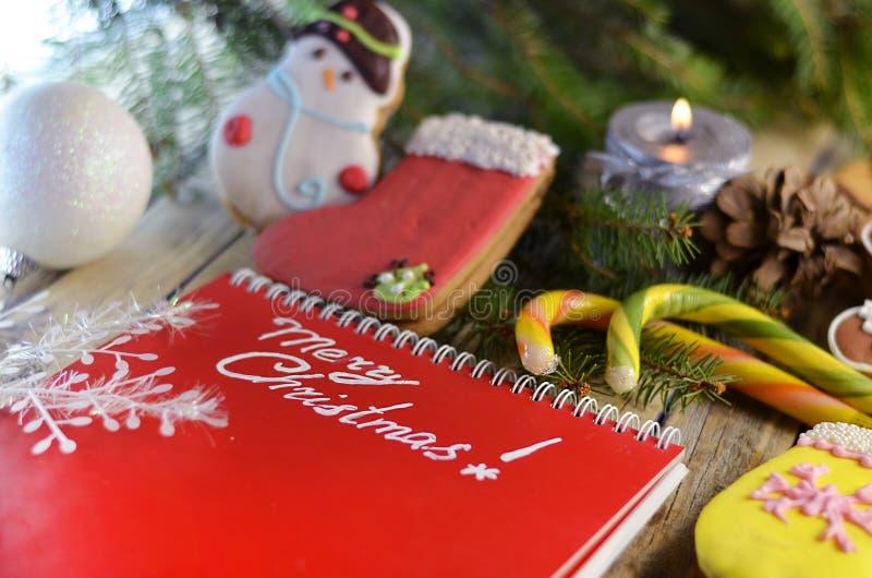 Γλυκά Χριστουγέννων και χαιρετισμοί Χριστουγέννων στοκ φωτογραφίες