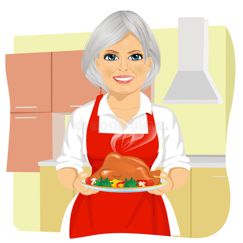 Γλυκιά γιαγιά στην κόκκινη ποδιά που μαγειρεύει την παραδοσιακή ημέρα των ευχαριστιών Τουρκία απεικόνιση αποθεμάτων