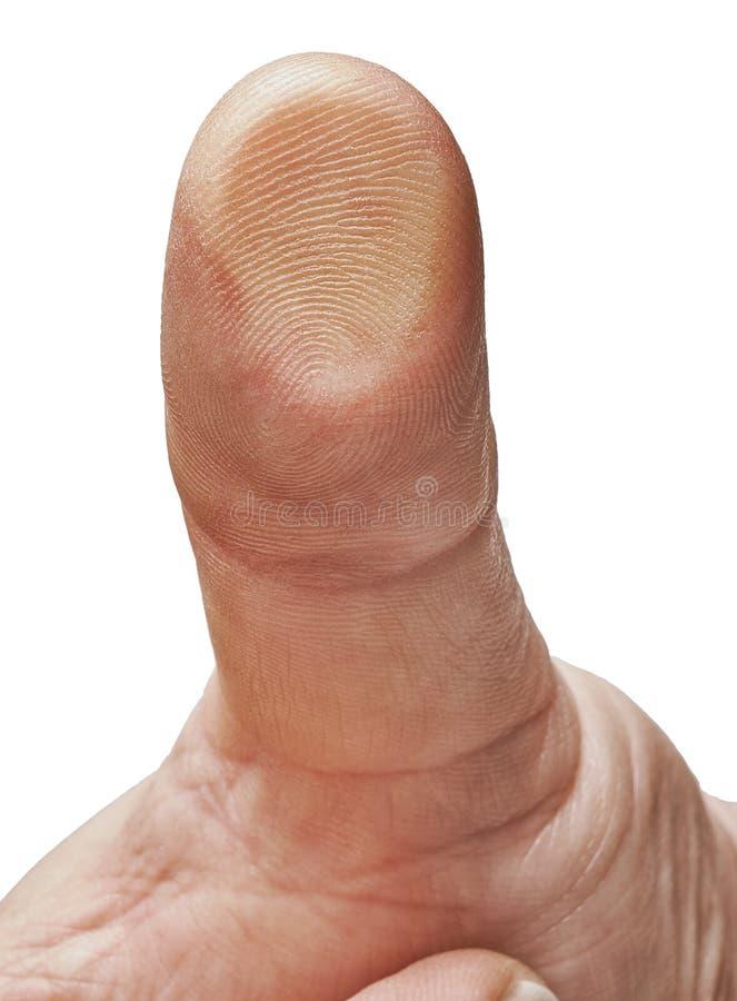 Δάχτυλο που πιέζεται ενάντια στο γυαλί με τις τυπωμένες ύλες στοκ εικόνες