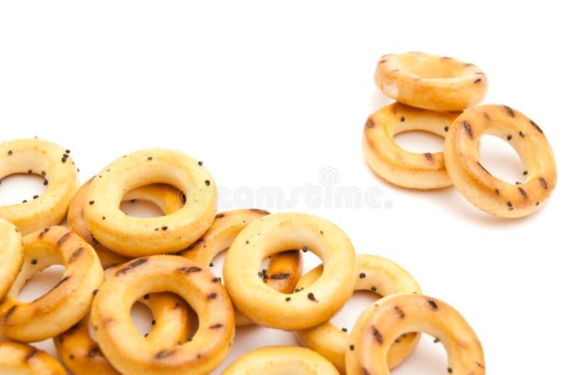 Δέσμη νόστιμα bagels στο λευκό στοκ φωτογραφία με δικαίωμα ελεύθερης χρήσης