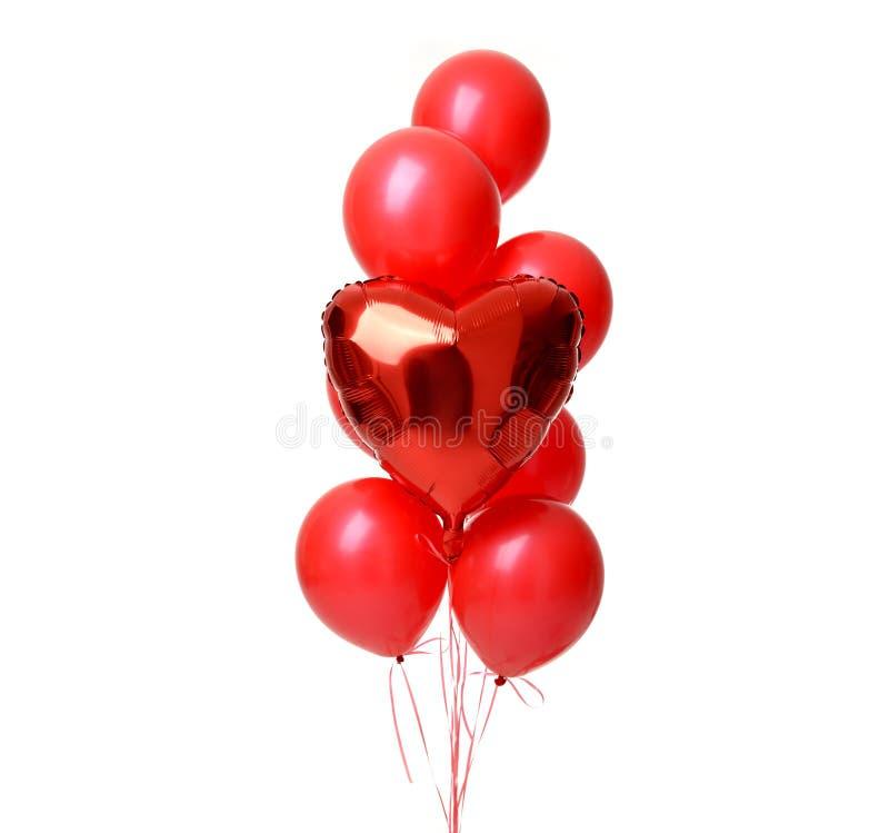 Δέσμη του μεγάλου λατέξ και του μεταλλικού κόκκινου αντικειμένου μπαλονιών καρδιών για τη γιορτή γενεθλίων στοκ φωτογραφίες