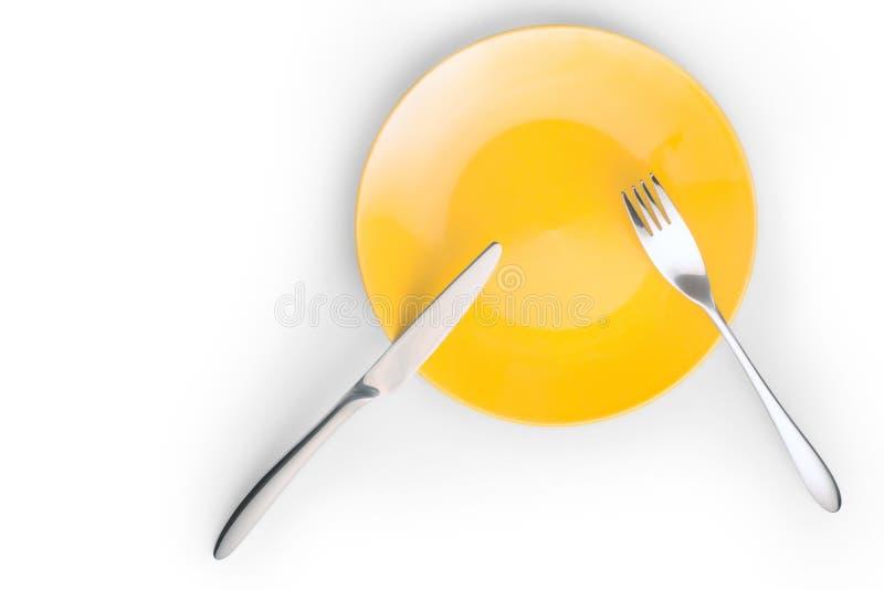 Δίκρανο και μαχαίρι στο κίτρινο πιάτο που απομονώνεται στοκ φωτογραφία με δικαίωμα ελεύθερης χρήσης