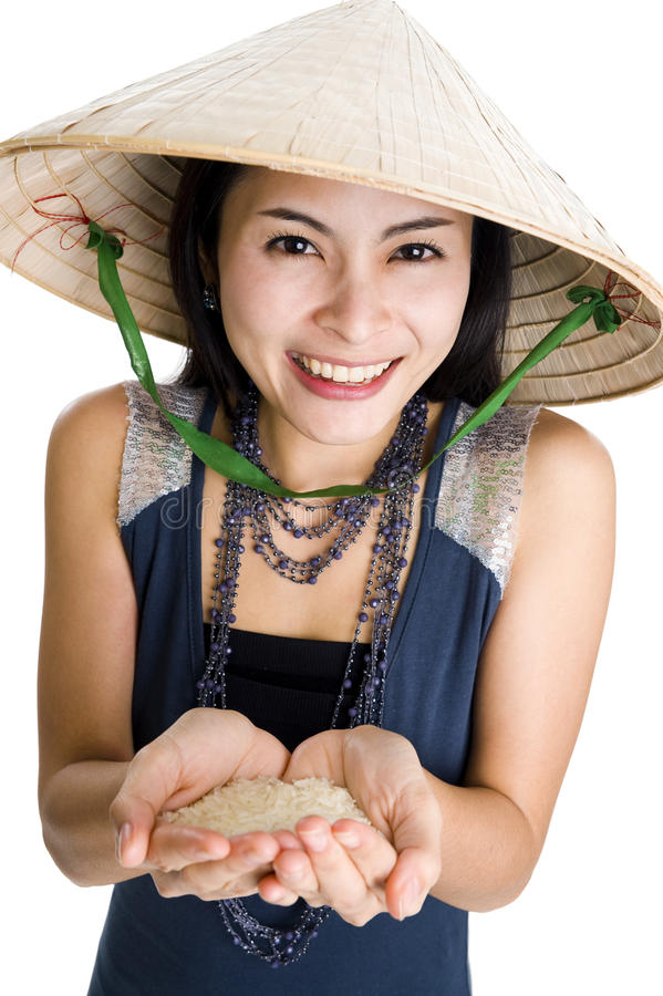 δίνει τη γυναίκα ρυζιού τη& στοκ εικόνα με δικαίωμα ελεύθερης χρήσης