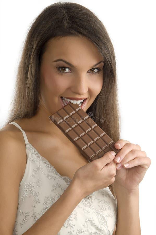 δαγκώνοντας σοκολάτα στοκ εικόνα με δικαίωμα ελεύθερης χρήσης